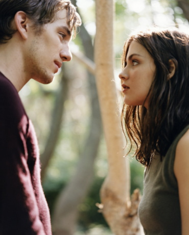 Young couple outdoors, looking at each other